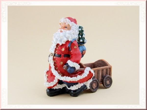 Weihnachtsmann mit Handwagen