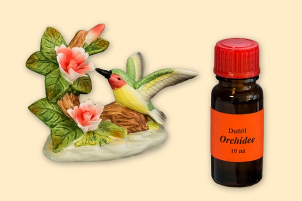 Porzellan Blume, Blüte rot-weiß mit Kolibri und einer Flasche Duftöl