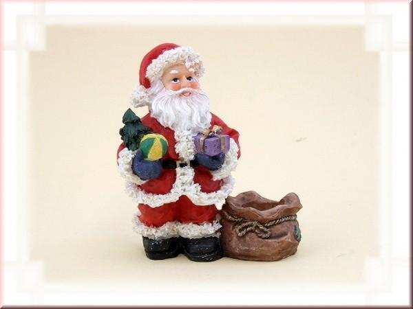 Weihnachtsmann mit Geschenken und Sack