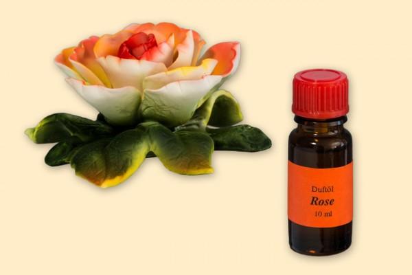 Porzellan Blume, rot-rosane Blüte aus Porzellan mit einer Flasche
