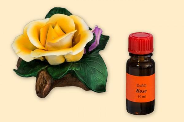 Porzellan Blume, Blüte gelb mit einer Flasche Duftöl