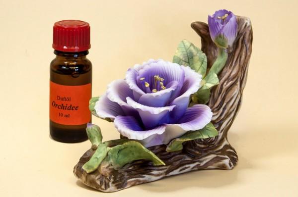 Porzellan Blume, Blüte lila mit einer Flasche Duftöl