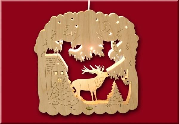 Fensterbild Winterlandschaft mit Hirsch beleuchtet