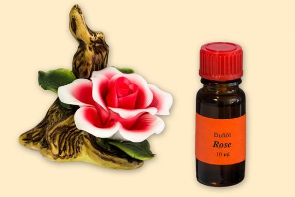 Porzellan Blume, rot-weiße Blüte mit einer Flasche Duftöl