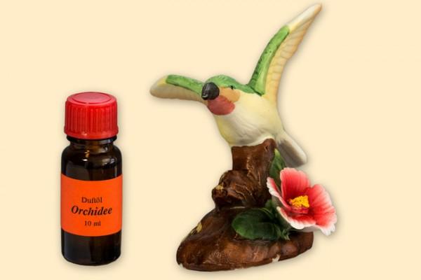 Porzellan Blume, rot-weiße Blüte und Kolibri mit einer Flasche Duftöl