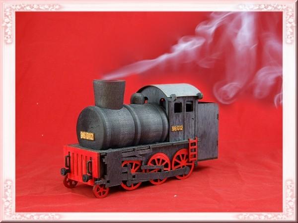 Dampfende Räucherlokomotive schwarz