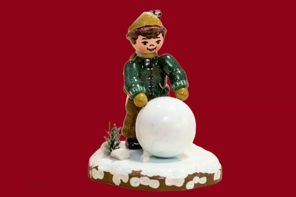Winterkind Junge mit Schneekugel