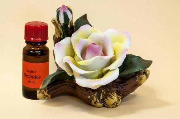 Porzellan Blume, gelb-rosane Blüte mit einer Flasche Duftöl